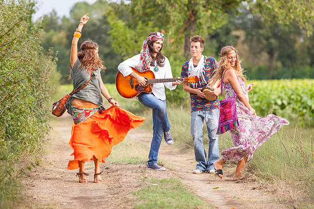 Hippie Group Playing Music and Dancing Outside